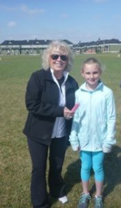 Moyra with Abigayle receiving her popsicle.  Special thanks from CPFF.